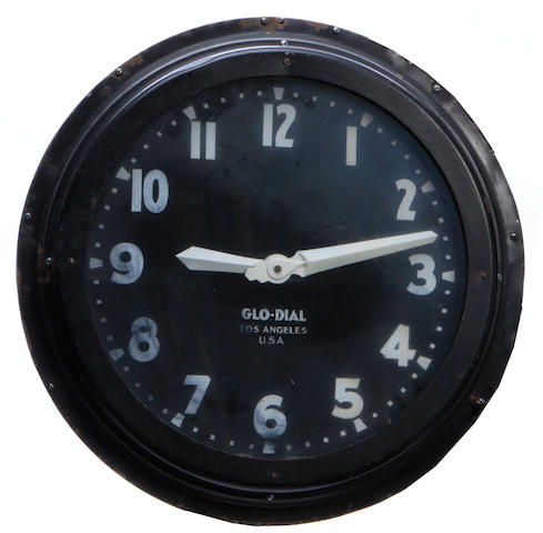 A circular neon wall clock
