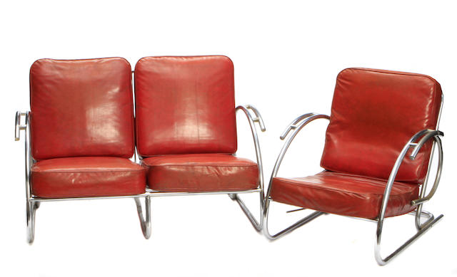 An Art Moderne tubular metal and upholstered sofa and armchair