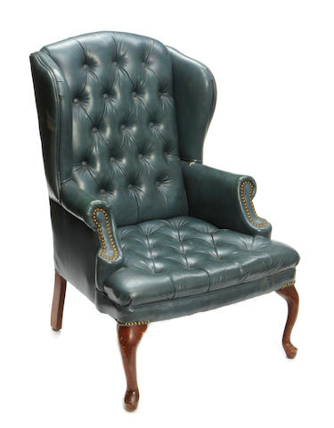 A Queen Anne style leather upholstered wing back armchair