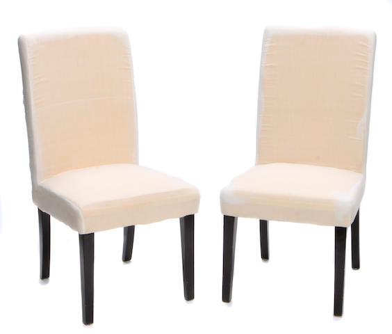 A group of three contemporary side chairs