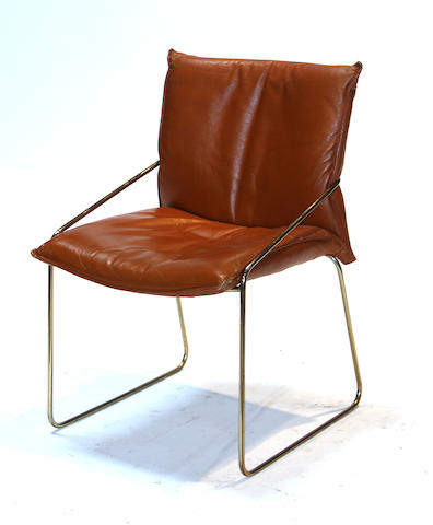 A set of four contemporary brown leather and metal armchairs