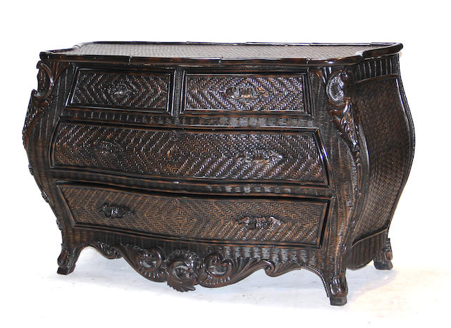 A Rococo style faux bamboo and rattan bombe commode fourth quarter 20th century