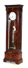 A William IV style mahogany tall case tubular chiming clock