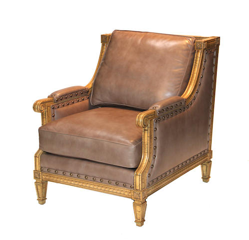 A pair of Louis XVI style painted leather upholstered bergeres