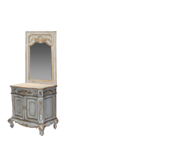 An Italian Rococo style parcel gilt painted credenza and mirror