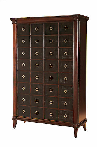 A George III style leather inset mahogany cabinet with silvered pulls