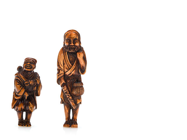 A wood netsuke of a fisherman signed Mitsumasa and a wood netsuke of a monkey trainer (lost tool in hand)