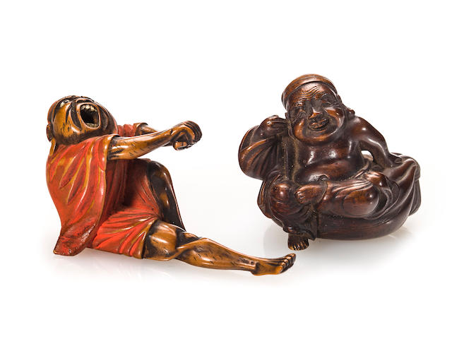 A wood netsuke of Daitoku on a treasure sack and a wood netsuke of Daruma stretching