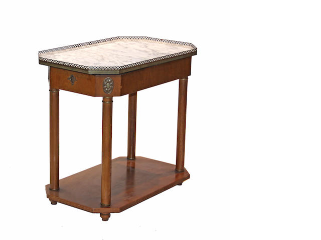 A pair of Charles X style fruitwood and marble side tables