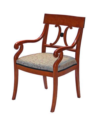 A set of four Biedermeier style parcel ebonized fruitwood armchairs 20th century