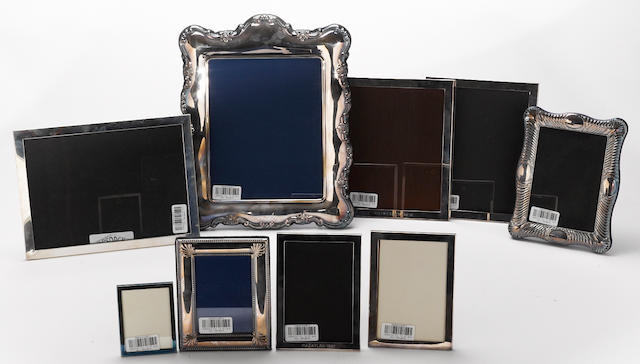 A silverplate mounted group of nine photo frames in assorted sizes