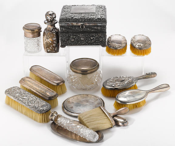 A sterling and sterling mounted assembled partial lady's dressing table set with beaded borders by Gorham Mfg. Co., Howard Sterling Co., International Silver Co. and Wallace, circa 1900  Monogrammed: GG  (15)