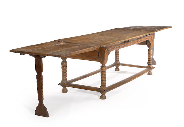 A Charles II walnut draw leaf table late 17th century