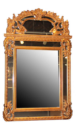 A Regence style giltwood mirror 20th century