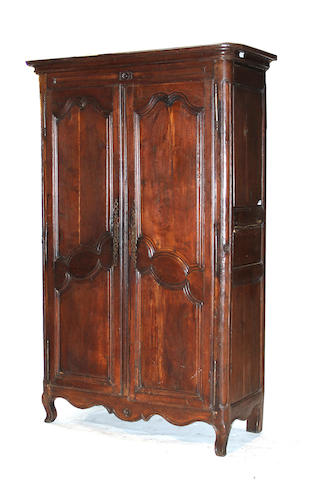 A Louis XVI provincial oak armoire third quarter 18th century