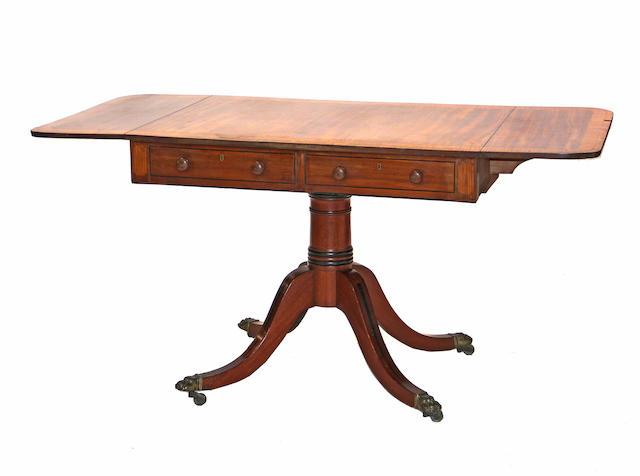 A Regency style crossbanded mahogany sofa table  late 19th century