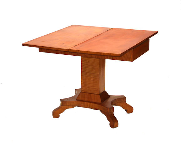 An American late classical tiger maple games table mid 19th century