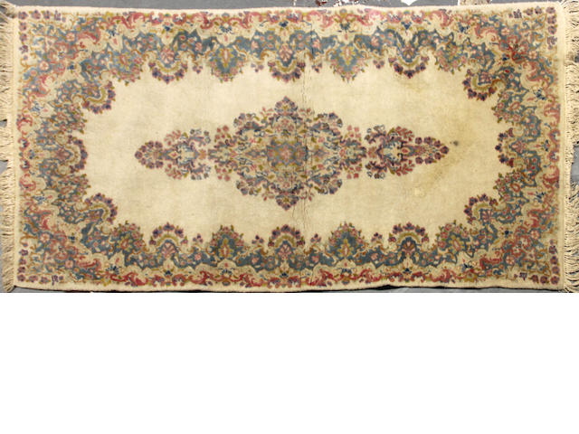 A Kerman carpet size approximately 3ft. 8in. x 7ft. 5in.