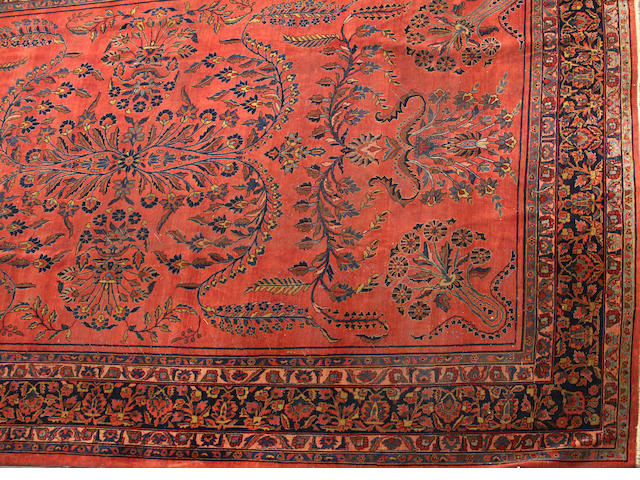 A Sarouk carpet size approximately 10ft. 6in. x 16ft. 9in.