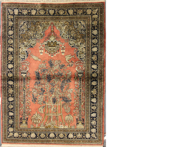 A Qum silk rug size approximately 3ft. 6in. x 5ft.