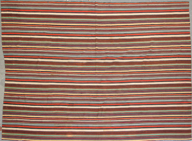 A Jijim kilim size approximately 4ft. 10in. x 6ft. 6in.