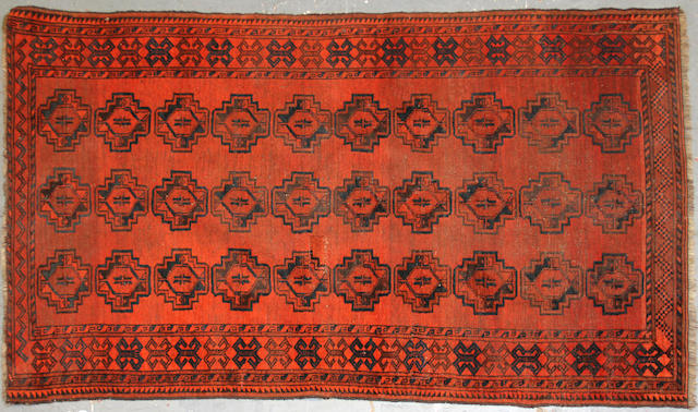 An Afghan rug size approximately 3ft. 9in. x 6ft. 4in.
