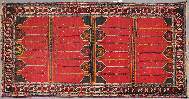 A Turkish rug size approximately 3ft. 4in. x 6ft. 6in.