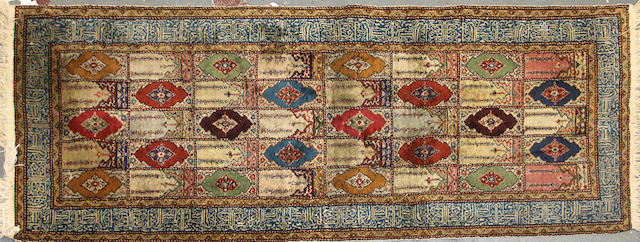 A Turkish rug size approximately 2ft. 10in. x 7ft.