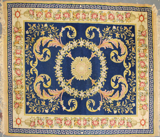 A Chinese carpet size approximately 6ft. 11in. x 8ft. 2in.