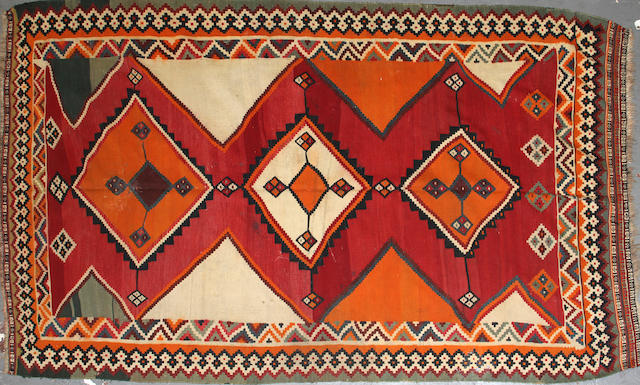 A Quashqi kilim size approximately 5ft. 2in. x 8ft. 5in.