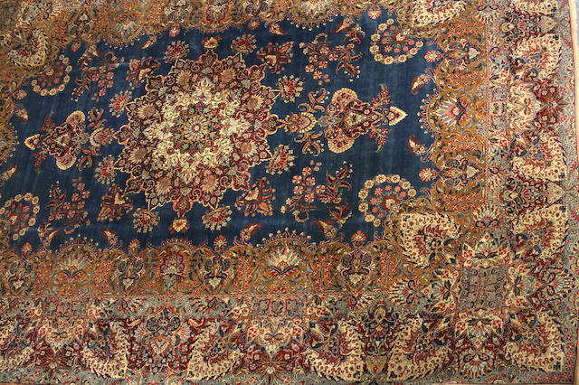 A Kerman carpet size approximately 11ft. 4in. x 15ft. 8in.