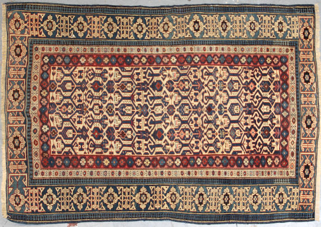 A Kuba carpet size approximately 3ft. 8in. x 5ft. 1in.