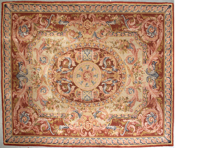 A Savonnerie style carpet size approximately 8ft. x 12ft.