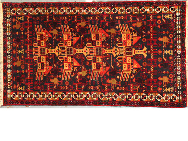 An Afghan rug size approximately 3ft. 2in. x 5ft. 7in.