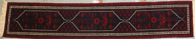 A Afghan kilim size approximately 1ft. 9in. x 9ft. 2in.