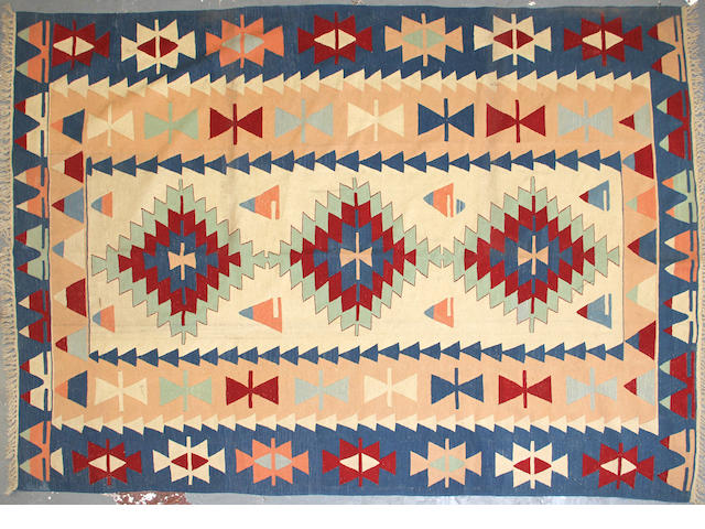 A Turkish kilim size approximately 7ft. 6in. x 10ft. 11in.