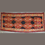 A Persian kilim size approximately 5ft. 2in. x 11ft. 9in.