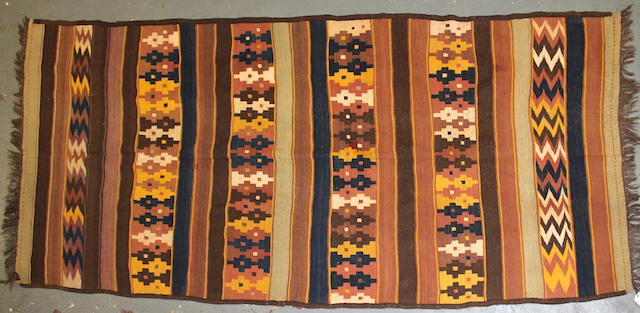 An Afghan kilim size approximately 5ft. 8in. x 12ft. 10in.