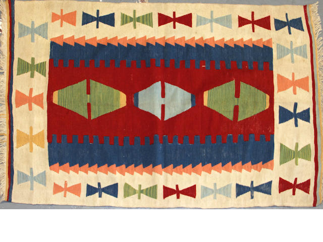 A Turkish kilim size approximately 4ft. x 6ft.