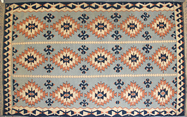 A Turkish kilim size approximately 6ft. 6in. x 10ft. 4in.