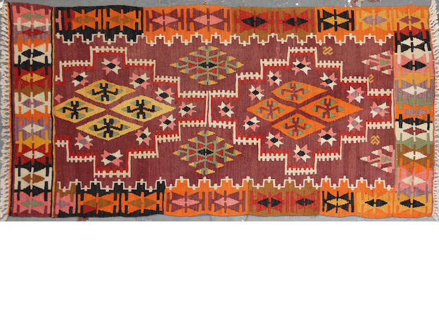 A kilim size approximately 2ft. 10in. x 5ft. 5in.