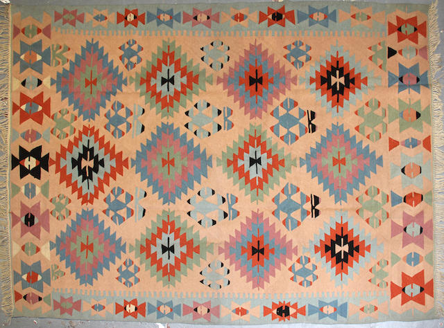 A Turkish kilim size approximately 7ft. 8in. x 10ft. 4in.