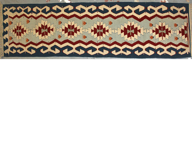 A Turkish kilim size approximately 2ft. 6in. x 9ft.