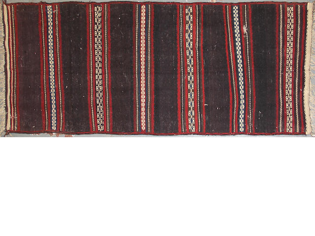 An Afghan kilim size approximately 3ft. 8in. x 9ft.