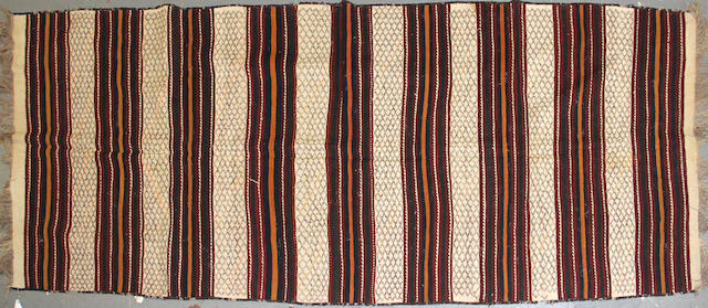 An Afghan kilim size approximately 5ft. 4in. x 13ft. 6in.