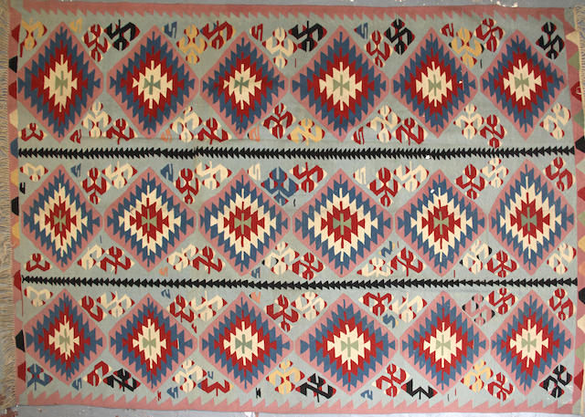 A Turkish kilim size approximately 7ft. 5in. x 11ft.