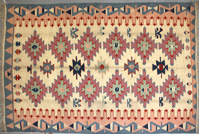 A Turkish kilim size approximately 6ft. 8in. x 10ft. 6in.