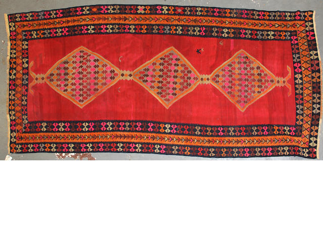 A Kilim size approximately 4ft. 8in. x 10ft.