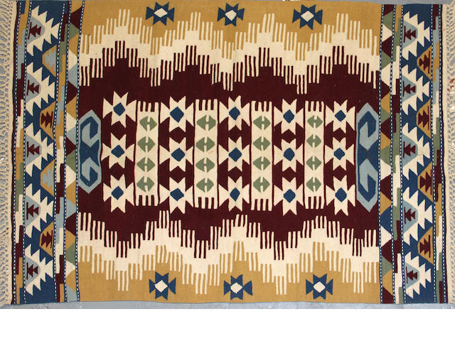 A Turkish kilim size approximately 3ft. 10in. x 5ft. 6in.