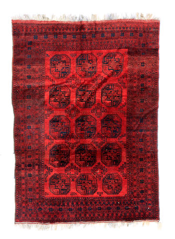 An Afgan Baluch carpet size approximately 7ft. x 10ft.